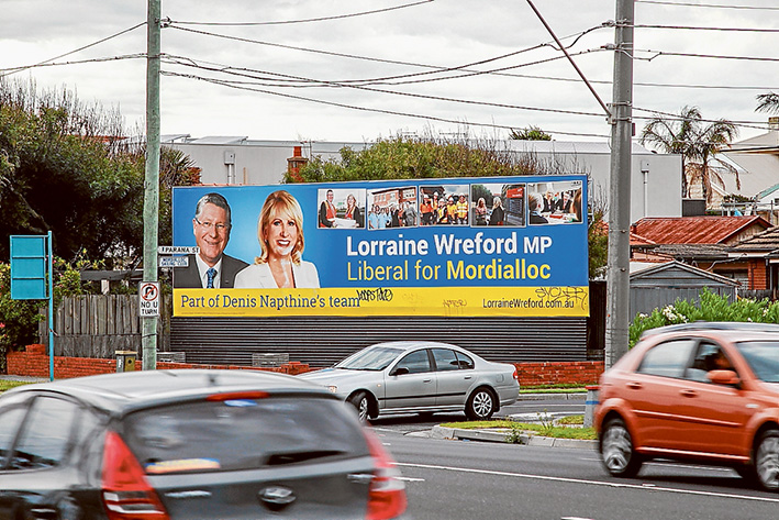 Unwanted sign: The election billboard in Aspendale of defeated premier Denis Napthine and former Mordialloc Liberal MP Lorraine Wreford. Picture: Gary Sissons