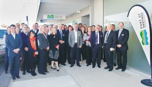 Boom times: Less than one year ago the expanding team of staff at the Port of Hastings Development Authority was celebrating the leasing of new offices in High St, Hastings. They were joined by Hastings MP Neale Burgess (who unveiled a plaque inside the offices), standing third from right with the authority's CEO Mike Lean. This week staff numbers are down to 14 and most of the office space will go unused. Picture: Gary Sissons