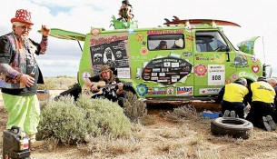 Trouble on the trail: Variety Hippies take a beer and song break after their van broke down on last year's Victorian Bash travails.