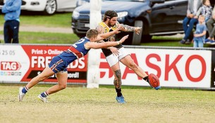No quarter given: Mornington got up over Frankston YCW in a low-scoring affair at the weekend. Picture: Gary Bradshaw