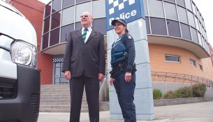 Bus trip: Leading Senior Constable Ingrid Ebert with Kevin Johnson, board member Menzies Caring for Kids, at the hand over of a mini bus that will ferry disadvantaged youth to programs run by Victoria Police youth resource officers and community groups.