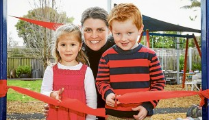Future funds: Chelsea Heights Kindergarten committee president Nicole Adams, Ashlee and Angus hope red tape can be cut to get on with a renovation to add a second room at the kinder. Picture: Gary Sissons
