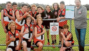 Strong message: Mt Martha Junior Football Club members proudly show off their smoke-free charter.