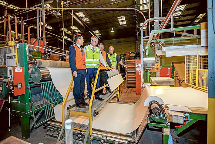 Production line: Armstrong World Industries staff Richard Ye, left, Isaacs Labor MP Mark Dreyfus, Michael Keam and Matthew Anderson at the vinyl manufacturer's Braeside plant. Picture: Yanni