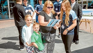Taking it to the streets: Frankston resident Louise Williams signs the petition handed over by Frankston Basketball Association member Tash Lesiuk. Picture: Yanni
