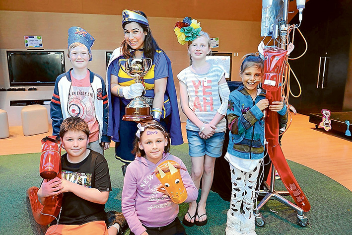 Up for the Cup: Royal Children's Hospital patients promote the Melbourne Cup Pin & Win fundraising campaign. Picture source: Victoria Racing Club, Facebook