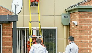 Rooftop search: Police and SES look for discarded weapons on day of the riot.