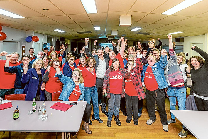 Four in a row: LABOR'S Mark Dreyfus, centre, celebrates his fourth successive federal election win in Isaacs with supporters at Mordialloc Bowls Club on election night. Pic: Gary Sissons