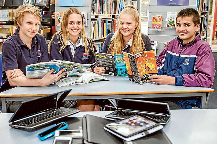 On same page: Cougar Raphael, left,Christine Bantow, Megan Stenson and Seth Ali enjoy some time out from technology at Patterson River Secondary College. Picture: Yanni