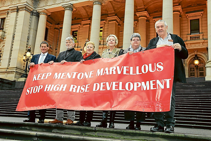 Drastic steps: CR Geoff Gledhill, left, Tony Brooker, Dorothy Booth, Margaret Motram, Sue Blackford and David Banks make their feelings known about a state government intervention to open up the possibility of high-rise development in central Mentone.