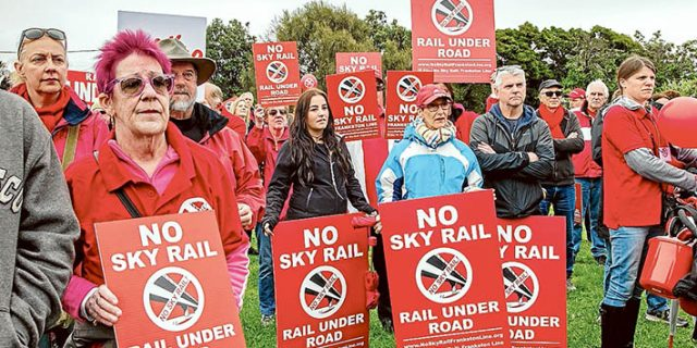 Seeing red: No Sky Rail: Frankston Line marchers gathered on Sunday to protest against elevated rail along the Frankston line. Picture: Gary Sissons